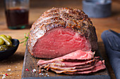 Roast beef on cutting board