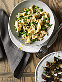 Pasta with morels, ramps and peas overhead