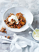 Pear and coconut crumble with with double-thick cream