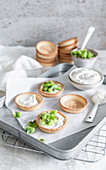 Kiwi tartlets with coconut cream being made