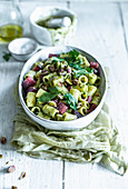 Rigatoni with pistachio pesto and salami