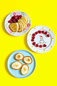 Pancakes with raspberries for breakfast with children