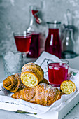 Croissants and raspberry juice