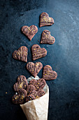 Chocolate orange hearts (vegan) falling out of a paper bag