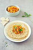 Injera, pancakes made from teff flour with lentil and carrot vegetables (Ethiopia)