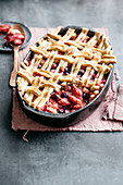 Rhubarb pie with apple and blueberries