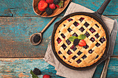 Homemade Traditional berry pie in a frying pan