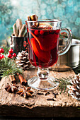 Hot mulled wine drink with lemon, apple, cinnamon, anise and other spices