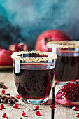 Healthy Pomegranate juice with fresh pomegranate fruits