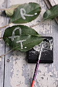 Leaves as name tags and crumbled chalk