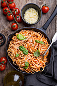 Spaghetti pasta with tomato sauce and basil