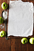 Green apples and baking paper
