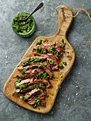 Sliced steak, with herb sauce