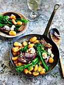 Pumpkin gnocchi with broccolini and red onion