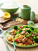 Stir-fried cashew chicken with water chestnuts and broccoli