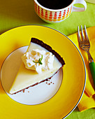 Key Lime pie with whipped cream on a yellow plate with a side of coffee