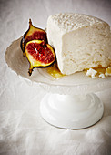 Figs, ricotta on a serving platter all in white