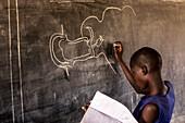 Schoolgirl drawing on a blackboard