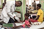 Doctor examining a young girl