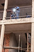 Construction workers welding railings