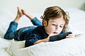 4 year old boy playing with a smartphone
