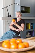 Man eating an orange