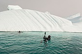 SCUBA diving next to iceberg in Eastern Greenland
