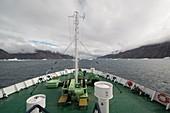 Ship cruising through icebergs, Fon Fjord, Greenland