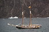 Sailing boat cruising in Fon Fjord, Greenland
