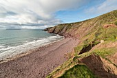 Red sandstone cliffs, Wales, UK