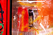 Vandalized public phone booth
