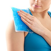 Woman with ice pack on her shoulder