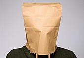 Person with brown paper bag on head