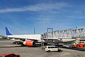Airliner docking at passenger bridge