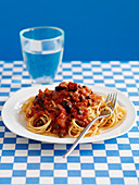 Spaghetti alla puttanesca (with tomatoes, capers and olives)