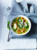 Minestrone with pesto and basil