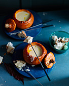 Cheese fondue in pumpkins, with white bread