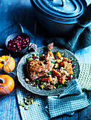 Spiced chicken with cous cous, pumpkin, mint and pomegranate