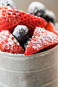 Strawberries and blueberries with powdered sugar