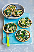 Tartlets with spinach, courgette and feta