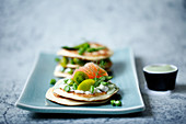Matcha cream cheese on pancakes with salmon and wide asparagous