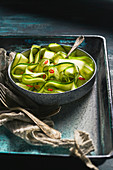 Spicy cucumber salad with peanuts and chili pepper