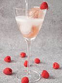 Prosecco balls with raspberries and water