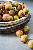Gooseberries in a stone bowl