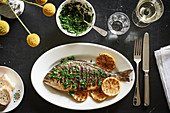 Roast sea bream with lemon and herbs