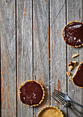 Salted caramel, chocolate and peanut butter tartlets