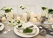 A Christmas table with wooden stars, lace ribbons and Christmas tree sprigs