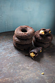 Vegan chocolate donuts filled with peanut butter