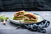 A vegan ciabatta sandwich with tofu and salad
