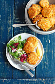 Pumpkin and barley fritters with salad
